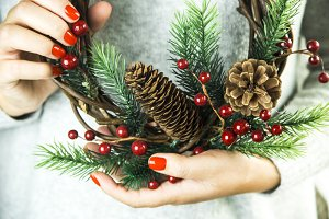 christmas concept - woman holding holiday attributes