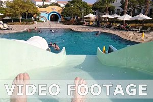 POV of a man riding water slide in water park