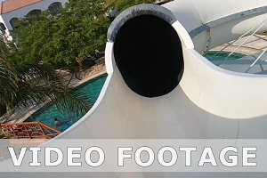 POV of a man riding water slide tube in water park