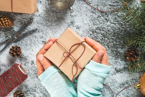 Girl hands with Christmas gifts