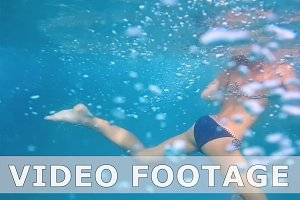 Girl underwater in swimming pool slow motion