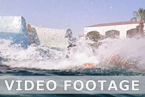 Running into pool from water slide in slow motion