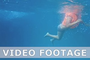 Boy underwater in swimming pool slow motion