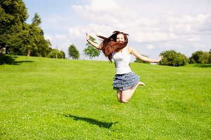 Young woman jumping outdoor