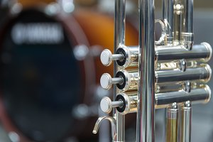 Trumpet on drum background