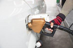Men hold Fuel nozzle