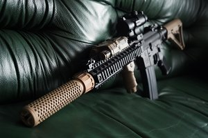 Home Defense Series. The Black Rifle On Sofa.