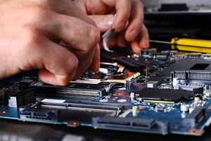 Computer literacy repair men hands, man examines laptop clean thermal paste