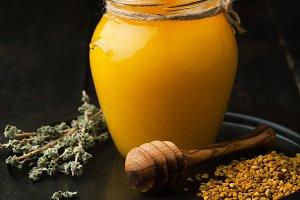Jar with honey, oregano
