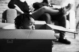 African kid playing inside a box
