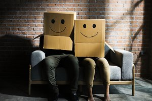 Couple wearing smilley face box