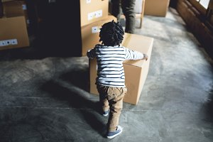 African kid playing with a box