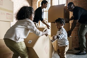 African family unpacking stuffs