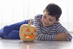 Cute boy with a Halloween Pumpkin