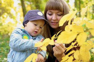 Mother with baby in autumn.