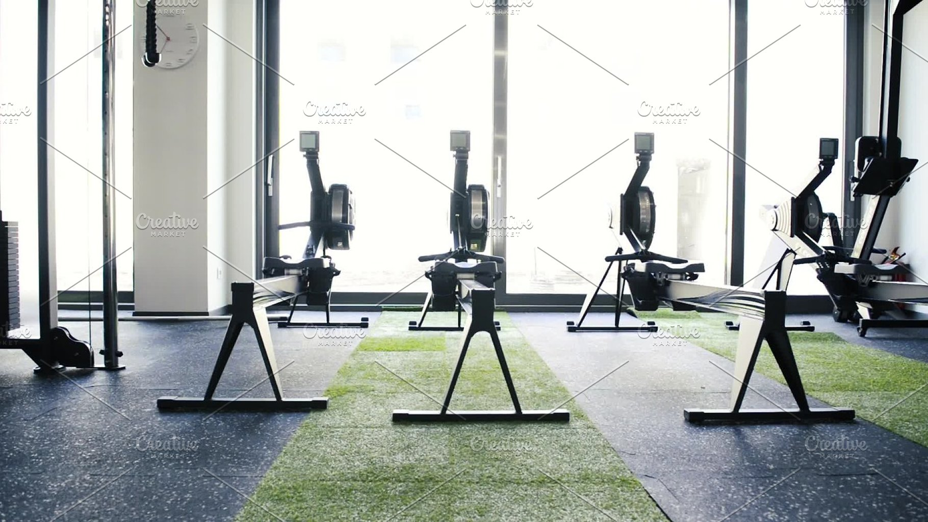 Rowing machines in empty modern gym room. fitness center. ~ sports