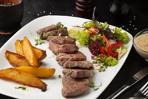 Grilled steak with spices