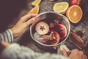 Mulled wine and ingredients in pot