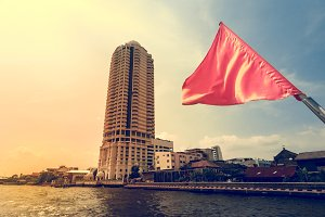 The waving red flag on boat cruising in Bangkok