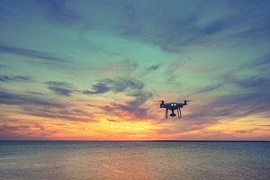 Silhouette of Drone Quad copter flying in sky