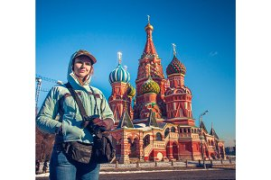 Happy young woman on Red Square in Moscow, Russia.