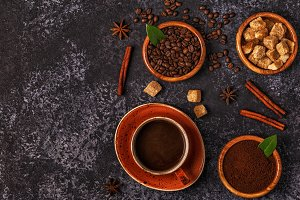 Coffee cup, beans, ground powder
