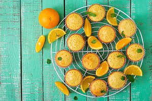Tasty muffins with oranges