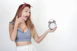 surprised girl with an alarm clock