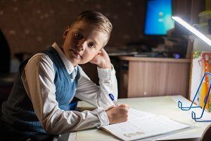 pupil boy does his homework