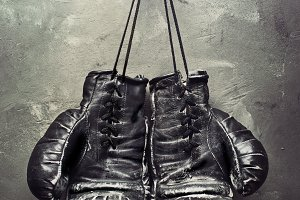 old boxing gloves hang