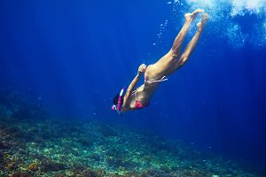 Woman swim underwater