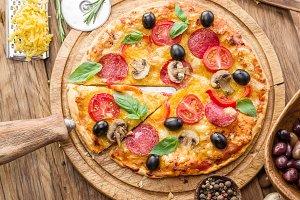 Pizza with mushrooms, salami