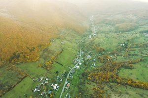 Aerial view of small town with hills, Slovakia. Autumn nature.
