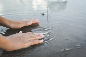 hand of girl and nature water