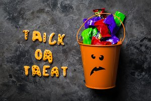 Halloween concept - basket with candies