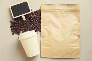 Bag of coffee and blank blackboard
