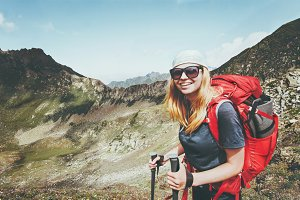 Happy woman hiking with backpack