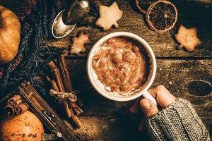 Autumn pumpkin spice latte on rustic wood background
