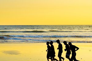 men running on the beach