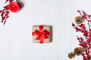 Christmas present on a wooden table background