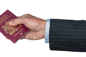 Senior caucasian hand holding UK passport