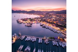 Aerial view of boats and beautiful city at night in Marmaris, Tu