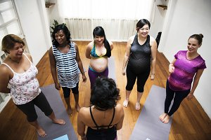 Pregnant woman in yoga class