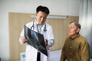Doctor with patient x-ray film