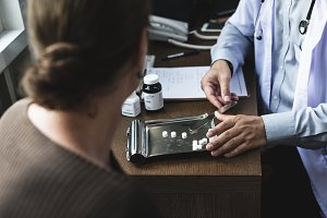 Doctor dividing medicine
