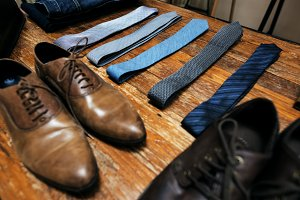 Close up of shoes and neck ties