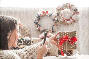 girl with Christmas gifts and a telephone