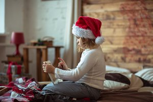 child  in santa hat on with tablet