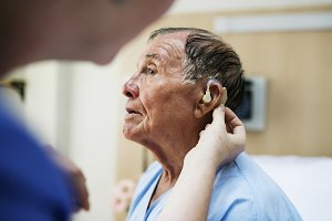 Elderly man wearing hearing aid