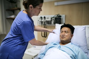 A sick Asian man in a hospital
